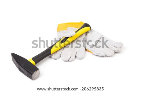 Construction gloves and hammer. Isolated on a white background.