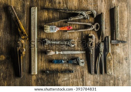 Construction hand tools on wood background
