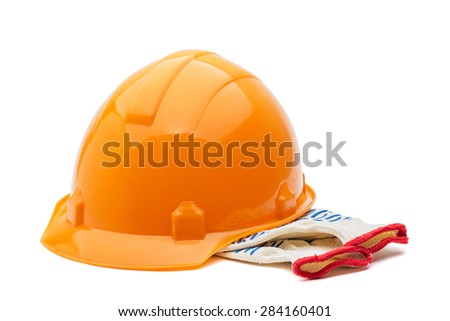 Construction hard hat and gloves on a white background - stock photo