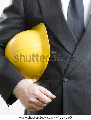 Construction hat under arms - stock photo
