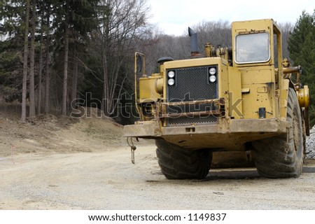 Construction Heavy Equipment Grater with Copy Space - stock photo