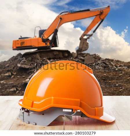 Construction helmet at construction site - stock photo