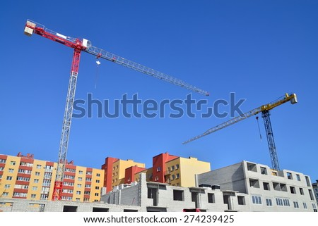 Construction house and crane against of blue sky - stock photo