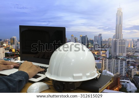 Construction  in city work Safety helmet  - stock photo
