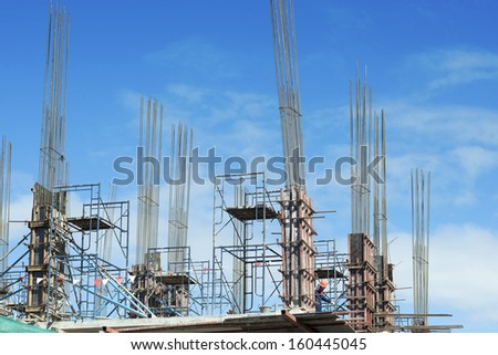 construction industry site work and workers in sunny day