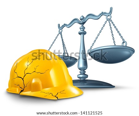 Construction injury law and work accident health hazards as a broken cracked yellow hardhat helmet and a scale of justice in a legal concept of worker compensation issues on a white background. - stock photo