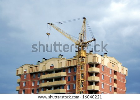 Construction. Lifting crane on the building new house - stock photo