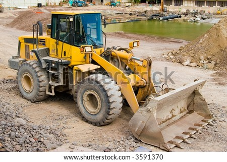 Construction loader at a job site ready to work