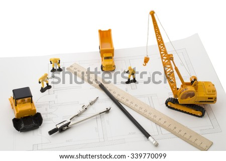 construction machinery and builders in the drawing of the apartment. Construction concept - stock photo