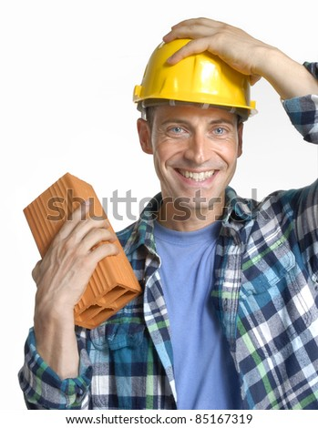 Construction man holding a wall brick on white background. Constructor holding a wall block on white background.