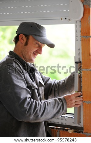 Construction man using level tool - stock photo