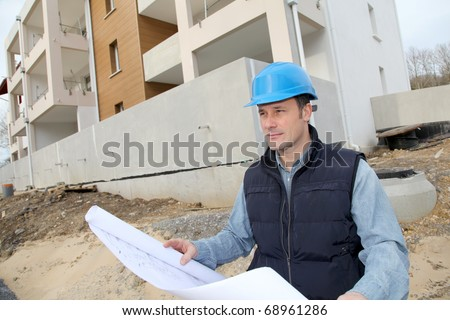 Construction manager on building site - stock photo