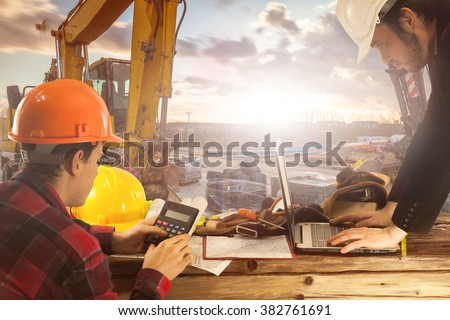 Construction manager on the construction site at sunset as a background Construction - stock photo