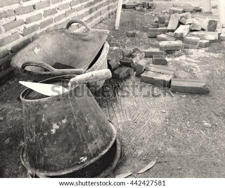 Construction masonry cement mortar tools on bucket. Black and White - stock photo