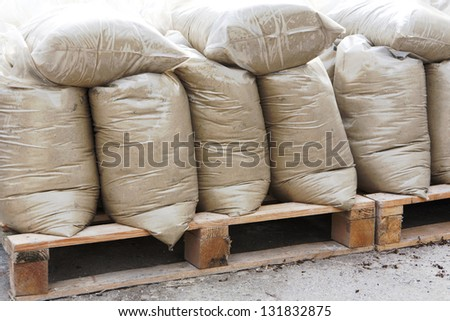 construction mixtures on wooden pallet at storehouse