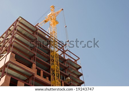 construction, new office building and crane. - stock photo