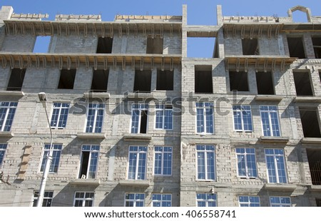 construction of a house on a background of blue sky - stock photo
