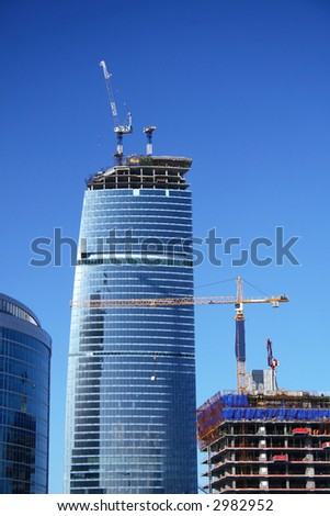 Construction of a modern city skyscraper (office building) - stock photo