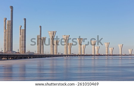 construction of a modern highway over the water - stock photo