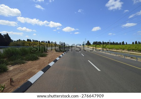 construction of a new four-lane road to the junction at different levels - stock photo