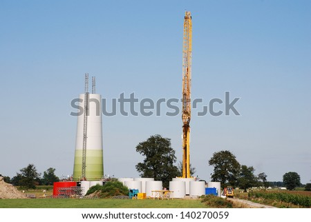 Construction of a new windturbine in the north of Belgium - stock photo