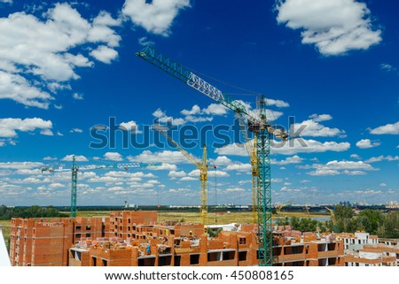 Construction of a residential high apartment building of brick.