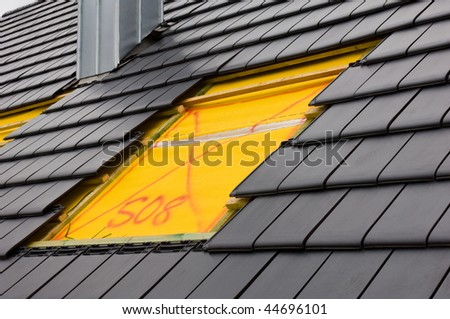 Construction of a roof light on a building site - stock photo
