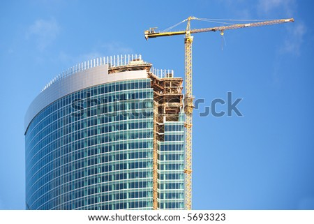 Construction of a skyscraper in Moscow, early morning - stock photo