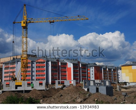 construction of a tenement-house, using lifting crane
