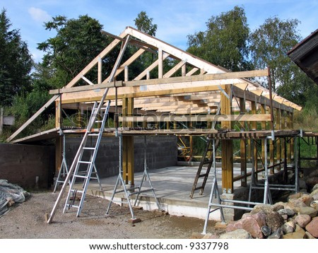 Construction of a wooden frame for a house - stock photo