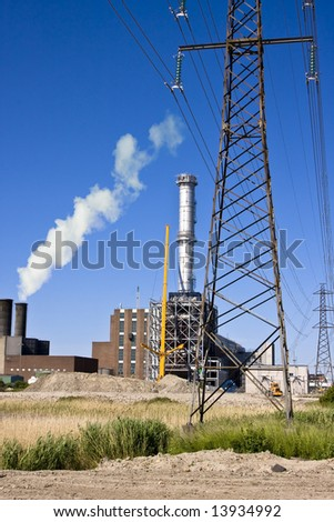 Construction of an industry with a big chimney on a clear blue sky