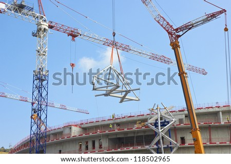 Construction of big buildings, tower cranes - stock photo