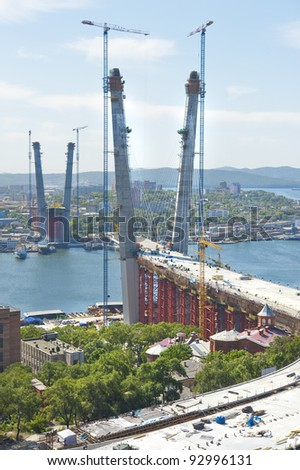 construction of big guyed bridge in the Russian Vladivostok over the Golden Horn bay - stock photo