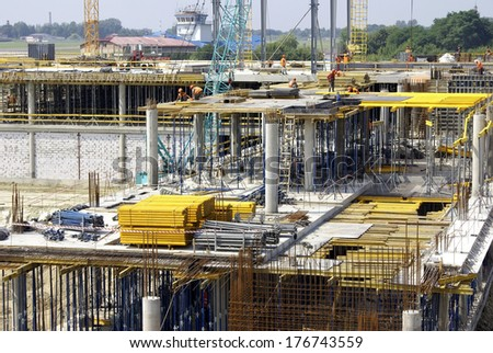 Construction of big industrial object with a lot of metal constructions - stock photo