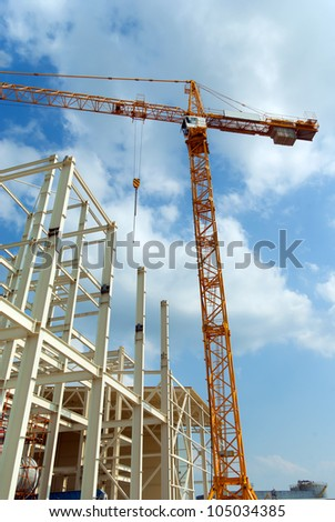 Construction of building a beautiful sky background - stock photo