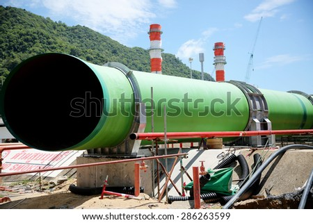 Construction of gas combine cycle power plant with cooling water piping system in Khanorm , southern region of Thailand. - stock photo