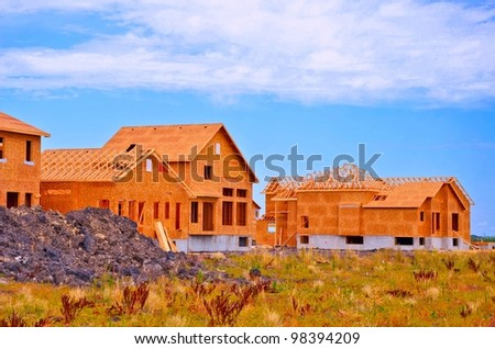 construction of homes in a new residential area - stock photo