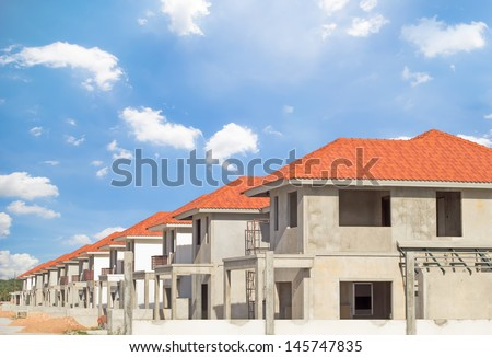 Construction of housing with clear sky background.