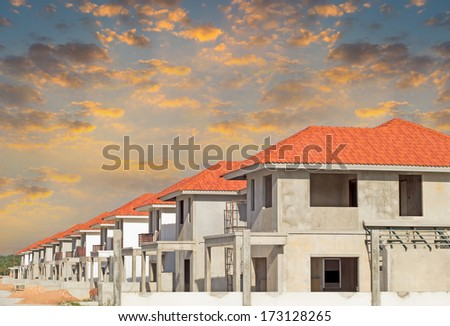 Construction of housing with sky background. - stock photo