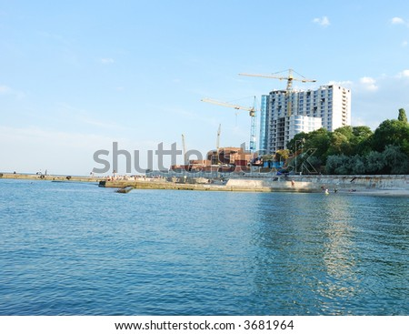 Construction of modern building on sea coast - stock photo