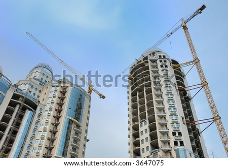 Construction of modern buildings - stock photo