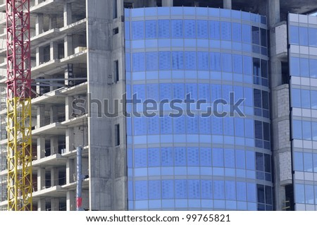 Construction of Modern Glass Building - stock photo