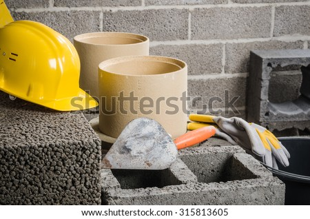 Construction of modular ceramic chimney in the house - stock photo