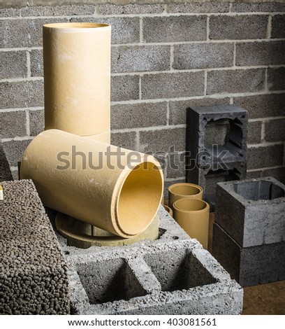 Construction of modular ceramic chimney in the house, close-up - stock photo