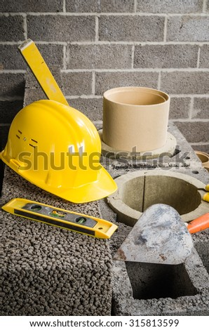 Construction of modular ceramic chimney in the house. Tools of the stovemaker - stock photo