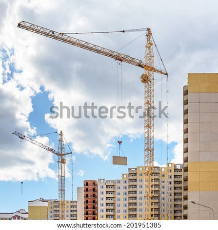 Construction of multi-storey residential building - stock photo