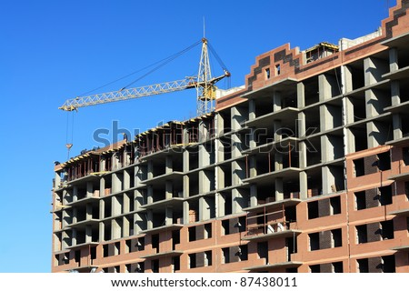 Construction of multi-storied brick houses - stock photo
