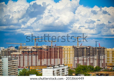 Construction of new buildings and beautiful sky with clouds - stock photo