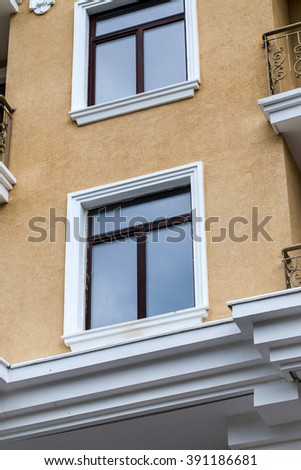 Construction of new high-rise luxury apartment buildings in crowded conditions of city streets. Modern buildings. Construction of a skyscraper. House. - stock photo