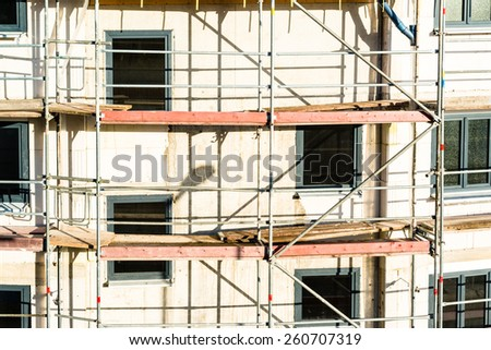 Construction of new house with new windows already mounted - stock photo